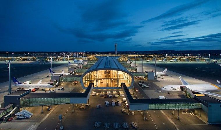 1280px-Oslo_Airport_terminal_night_view